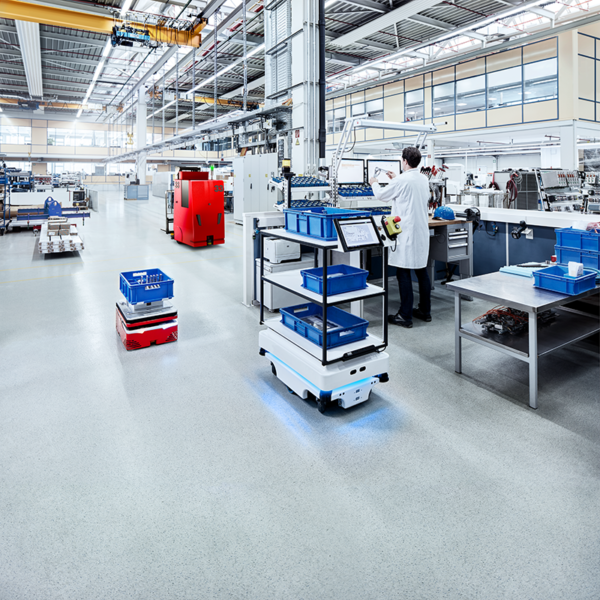 Autonomous Guided Vehicle in warehouse transporting materials