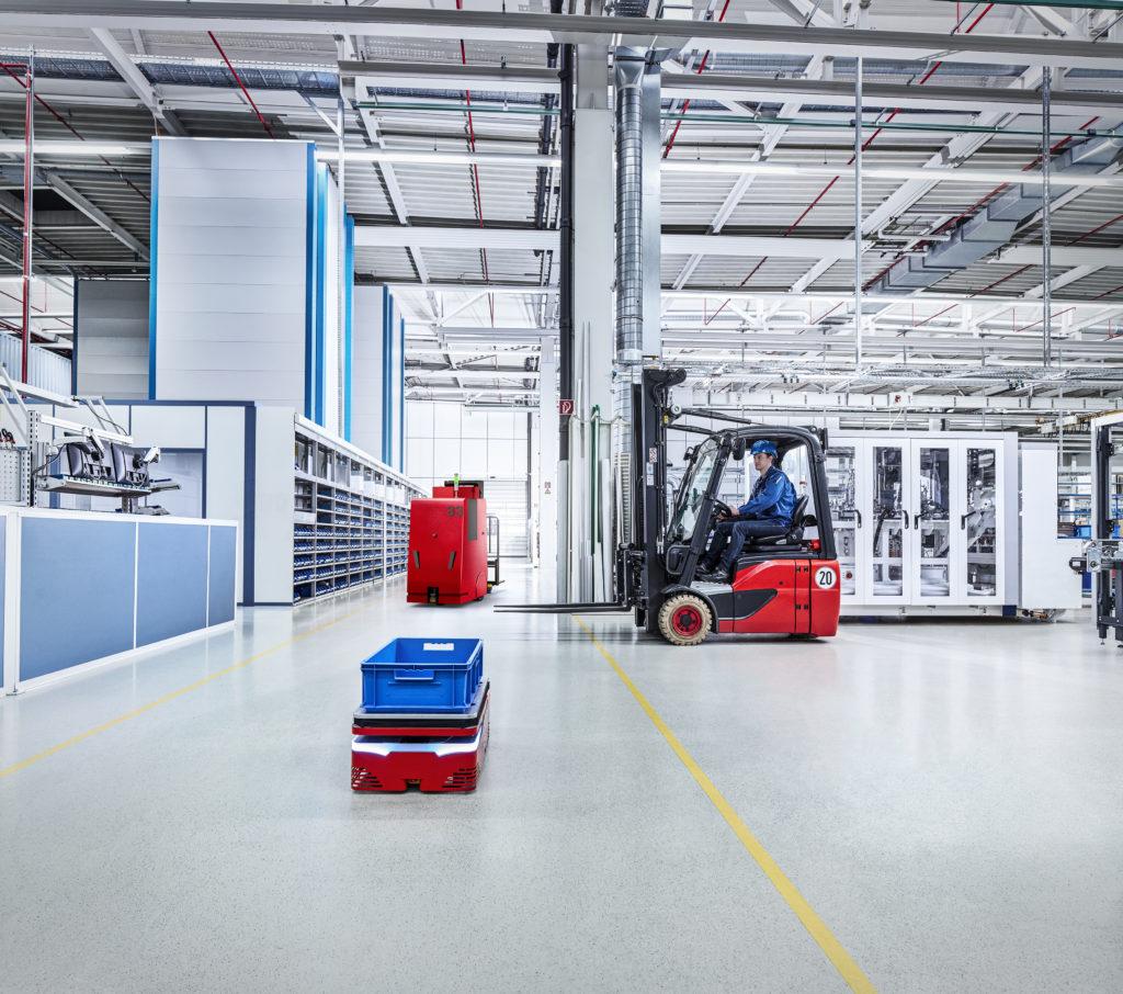 Autonomous Guided Cart (AGC) transports materials through warehouse