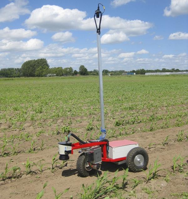 Agricultural robot navigating crop field with 2D laser scanner